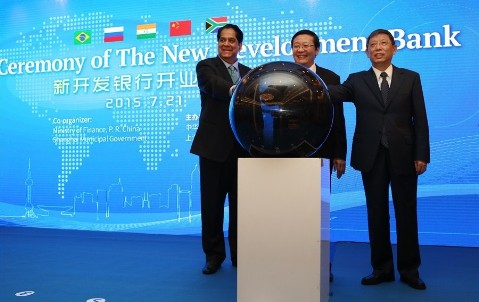21 July 2015. Shanghai Mayor Yang Xiong, Chinese Finance Minister Lou Jiwei and KV Kamath, president of the New Development Bank, celebrate together as the New Development Bank, was officially launched in Shanghai. Credit: www.ndbbrics.org