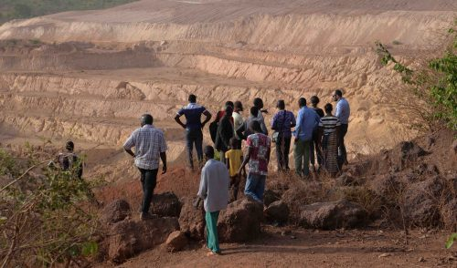 Overlooking the first AngloGold Ashanti mine in the Siguiri region of Guinea. Approximately 380 households were forcibly evicted from their ancestral land to make way for the open-pit oxide goldmine. Click on the photo for more information. (Photo: Inclusive Development International)